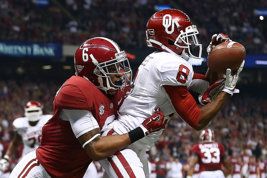 . NEW ORLEANS, LA - JANUARY 02:  Jalen Saunders #8 of the Oklahoma Sooners scores a touchdown over Ha Ha Clinton-Dix #6 of the Alabama Crimson Tide during the Allstate Sugar Bowl at the Mercedes-Benz Superdome on January 2, 2014 in New Orleans, Louisiana.  (Photo by Streeter Lecka/Getty Images)