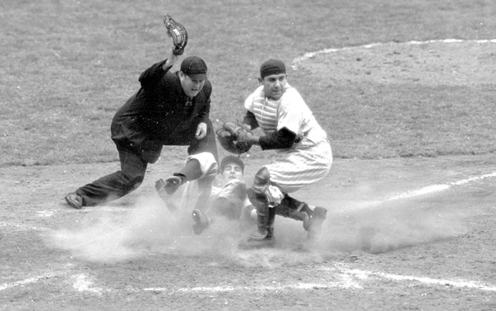 . In this Oct. 6, 1950, file photo, Philadelphia Phillies shortstop Granny Hamner is tagged at the plate by New York Yankees catcher Yogi Berra as he tries to score from third in the ninth inning of Game 3 of the World Series,  at Yankee Stadium in New York.  The umpire is Dusty Boggess.  The Yankees won 3-2.  Game 1 of the 2009 World Series is scheduled for Wednesday Oct. 28 in New York. (AP Photo/File)