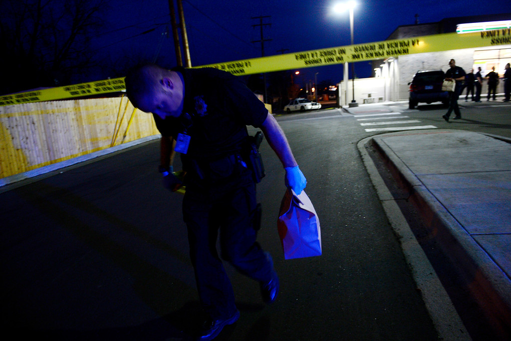 . DENVER, CO - APRIL 29: Evidence is taken from the crime scene at the 7-Eleven near 6th and Federal Boulevard after a boy shot nearby and taken to the convenience store. The child who was shot was reported to be in critical condition. (Photo by AAron Ontiveroz/The Denver Post)