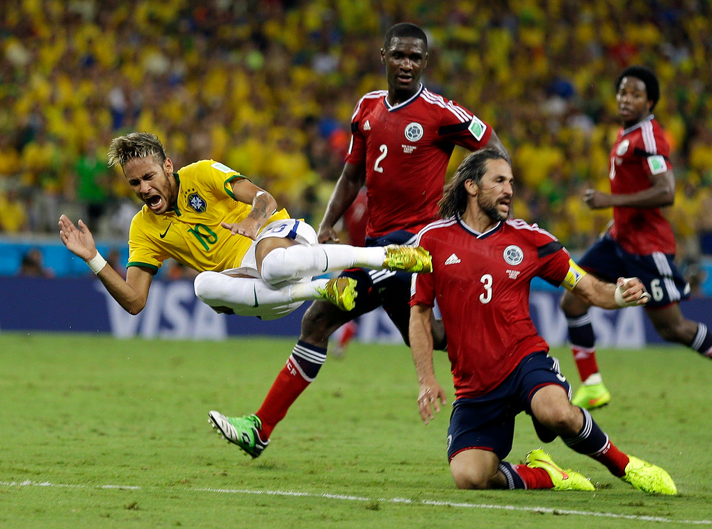 . Brazil\'s Neymar is airborne after running in to Colombia\'s Mario Yepes during the World Cup quarterfinal soccer match between Brazil and Colombia at the Arena Castelao in Fortaleza, Brazil, Friday, July 4, 2014. (AP Photo/Natacha Pisarenko)