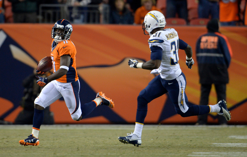 . Denver Broncos wide receiver Trindon Holliday (11) runs back the kick off to start the gam. The Denver Broncos vs. the San Diego Chargers at Sports Authority Field at Mile High in Denver on December 12, 2013. (Photo by Joe Amon/The Denver Post)