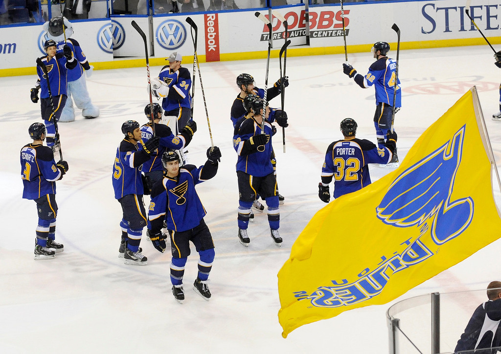 . St. Louis Blues acknowledge their fans after defeating the Colorado Avalanche in an NHL hockey game Tuesday, April 23, 2013, in St. Louis. The Blues won 3-1 and clinch a playoff spot with the victory. (AP Photo/Bill Boyce)