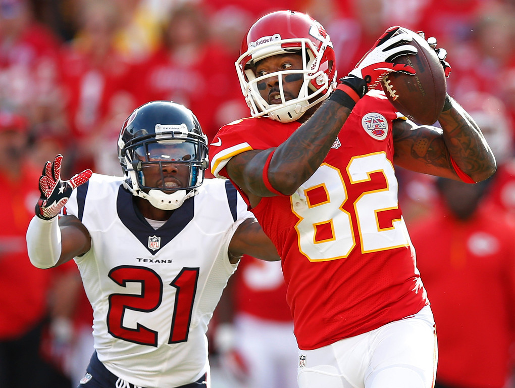 . Kansas City Chiefs wide receiver Dwayne Bowe (82) catches a pass while covered by Houston Texans cornerback Brice McCain (21) during the first half of an NFL football game at Arrowhead Stadium in Kansas City, Mo., Sunday, Oct. 20, 2013. (AP Photo/Ed Zurga)