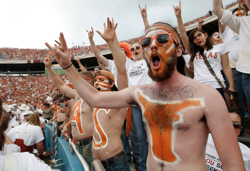 . Texas fans cheer during the first half of an NCAA college football game against the Oklahoma at the Cotton Bowl Saturday, Oct. 12, 2013, in Dallas. (AP Photo/Brandon Wade)