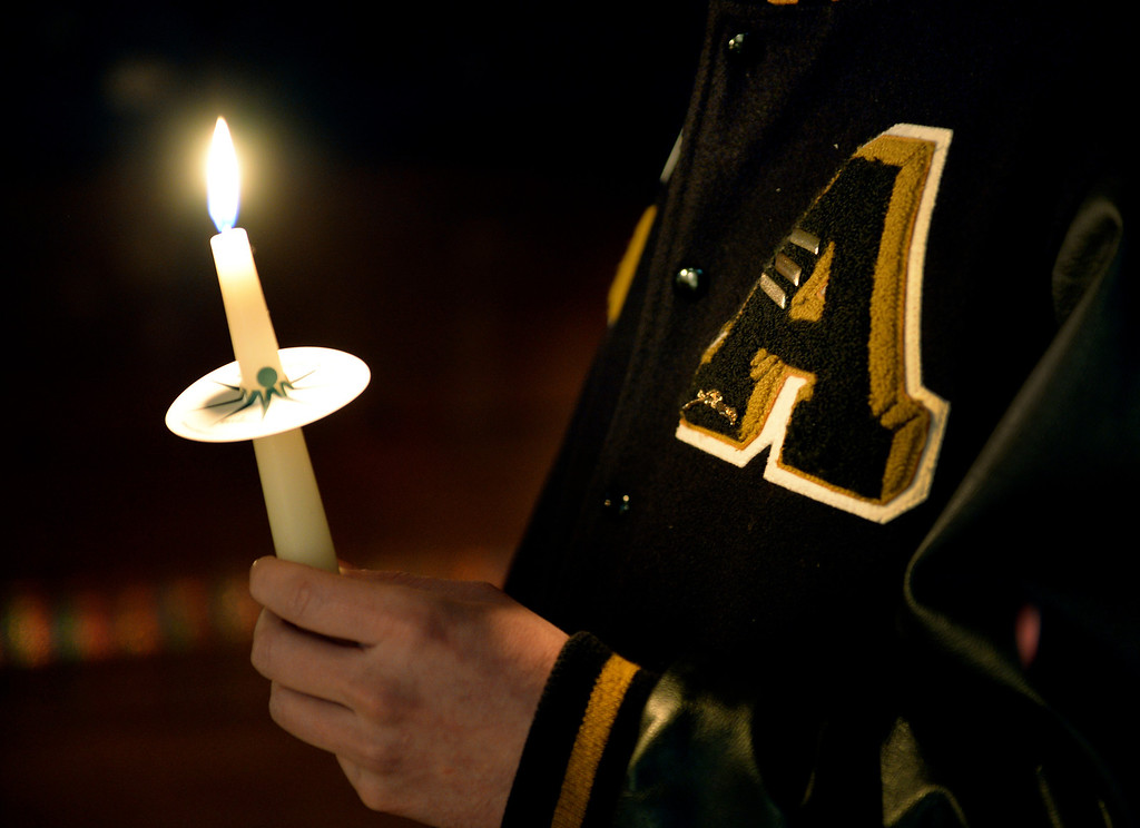 . CENTENNIAL, CO. - DECEMBER 20:  Arapahoe High School graduate Matt Hermsen held a candle Friday night during a vigil for Claire Davis. Reverend Bradley Stoltenow led the vigil at Shepherd of the Hills Lutheran Church December 20, 2013. Photo By Karl Gehring/The Denver Post