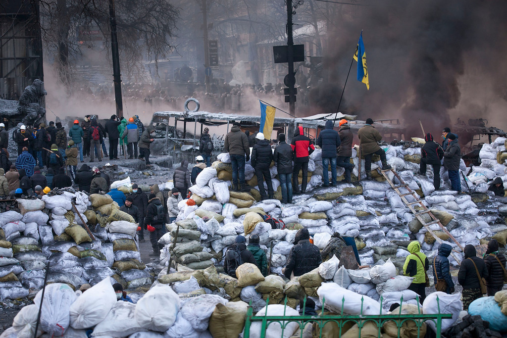. Anti-government protestors gather near Dynamo Stadium on January 25, 2014 in Kiev, Ukraine. Violent protests in Ukraine have spread beyond the capital as President Viktor Yanukovych held crisis talks with three key opposition leaders. (Photo by Rob Stothard/Getty Images)