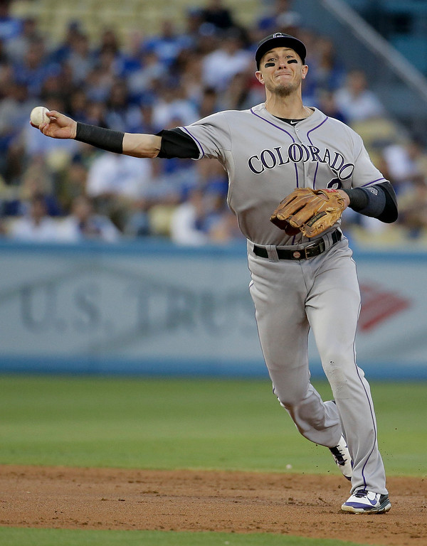 . Colorado Rockies shortstop Troy Tulowitzki throws Los Angeles Dodgers\' Clayton Kershaw out at first during second inning of a baseball game in Los Angeles, Wednesday, June 18, 2014. (AP Photo/Chris Carlson)