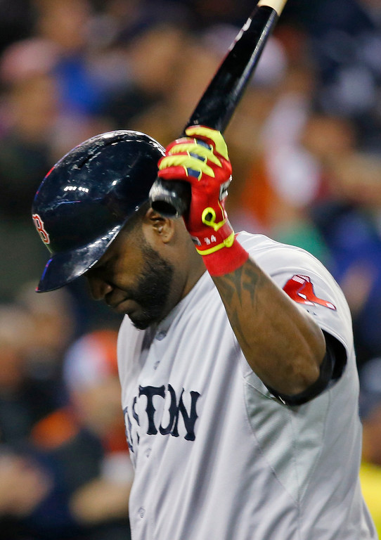 . Boston Red Sox\'s David Ortiz holds his bat after grounding out in the first inning during Game 5 of the American League baseball championship series against the Detroit Tigers, Thursday, Oct. 17, 2013, in Detroit. (AP Photo/Paul Sancya)