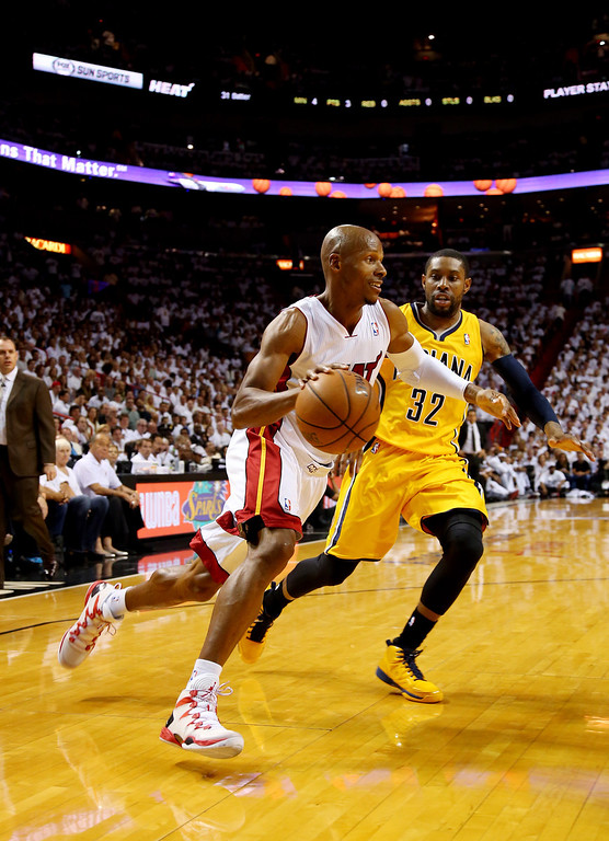 . MIAMI, FL - MAY 30: Ray Allen #34 of the Miami Heat drives to the basket against C.J. Watson #32 of the Indiana Pacers during Game Six of the Eastern Conference Finals of the 2014 NBA Playoffs at American Airlines Arena on May 30, 2014 in Miami, Florida.  (Photo by Mike Ehrmann/Getty Images)