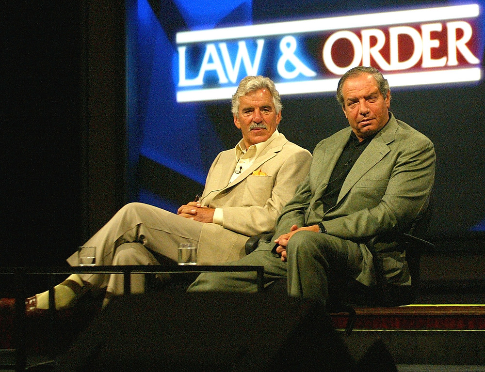 ". Actor Dennis Farina and Executive Producer/Creator Dick Wolf  of ""Law & Order\"" speak with the press during day two of the NBC Summer TCA Press Tour at the Century Plaza Hotel on June 11, 2004 in Los Angeles, California. (Photo by Frederick M. Brown/Getty Images)"