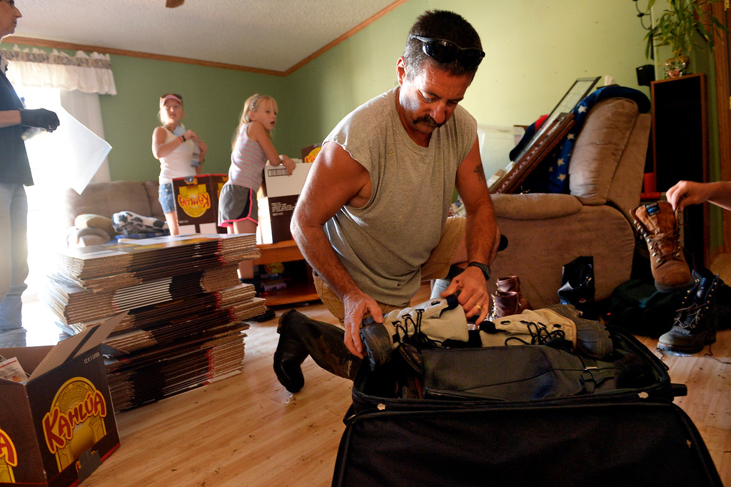 ". Scott Koester packs up belongings at his family\'s home in Lyons,  CO September 20, 2013. Koester expects that the home will be condemned after the recent flooding. He said, weve been here 10 years now and it\'s all gone. I don\'t know how you\'d save this house.""  Friday was the second day residents were allowed to return to their homes.  (Photo By Craig F. Walker / The Denver Post)"