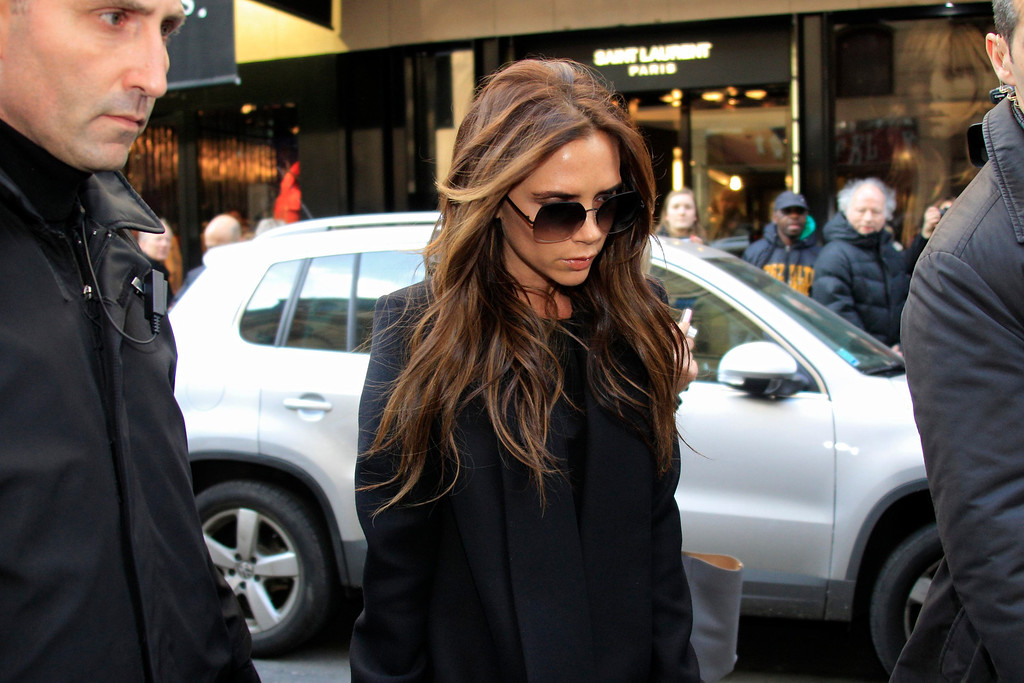 . Victoria Beckham, former Spice Girls singer and the wife of recently-signed Paris Saint-Germain soccer star David Beckham, leaves a luxury fashion store in Paris February 20, 2013.   REUTERS/Gonzalo Fuentes