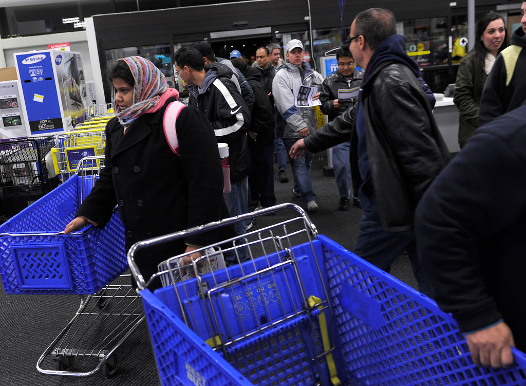 . Shoppers grabbed for shopping carts just after the doors opened  Thursday night, November 28, 2013 at the Best Buy store in Lone Tree. Many metro area stores got a jump on Black Friday by opening on Thursday. Best Buy remained open all night. Photo By Karl Gehring/The Denver Post
