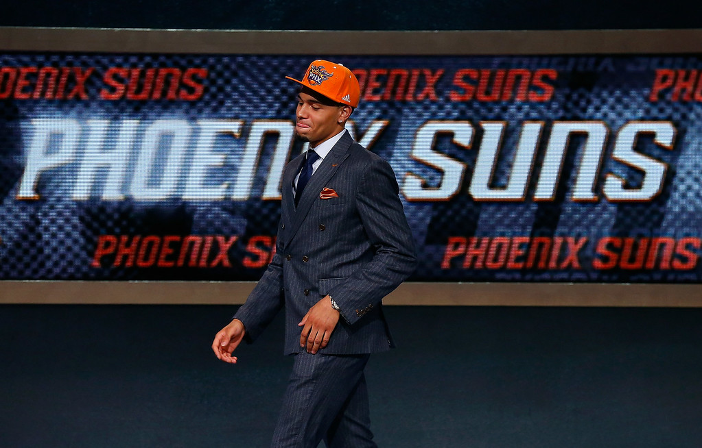 . Tyler Ennis of Syracuse walks on stage after being drafted with the #18 overall pick by the Phoenix Suns during the 2014 NBA Draft at Barclays Center on June 26, 2014 in the Brooklyn borough of New York City.   (Photo by Mike Stobe/Getty Images)
