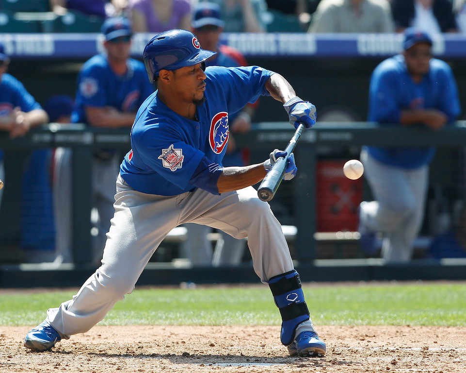 . Chicago Cubs\' Edwin Jackson puts own a sacrifice bunt against the Colorado Rockies in the fifth inning of a baseball game in Denver on Sunday, July 21, 2013. (AP Photo/David Zalubowski)