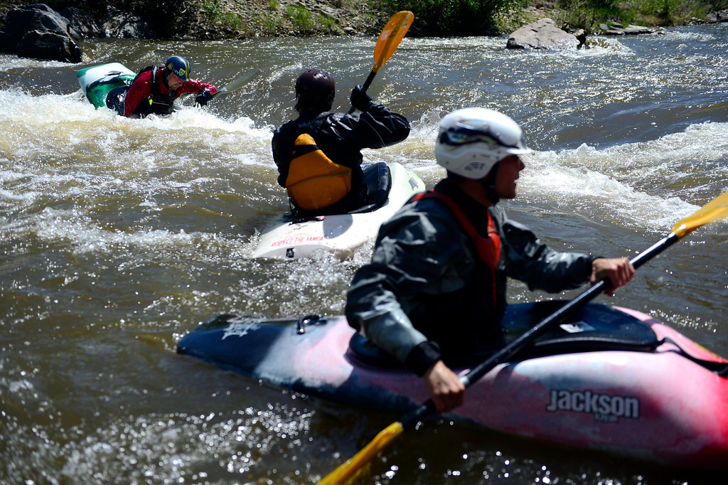 . Peter Kabezan, of Slovakia, works the rapids in a kayak during Golden Games at the Clear Creek Whitewater Park. (Photo by AAron Ontiveroz/The Denver Post)