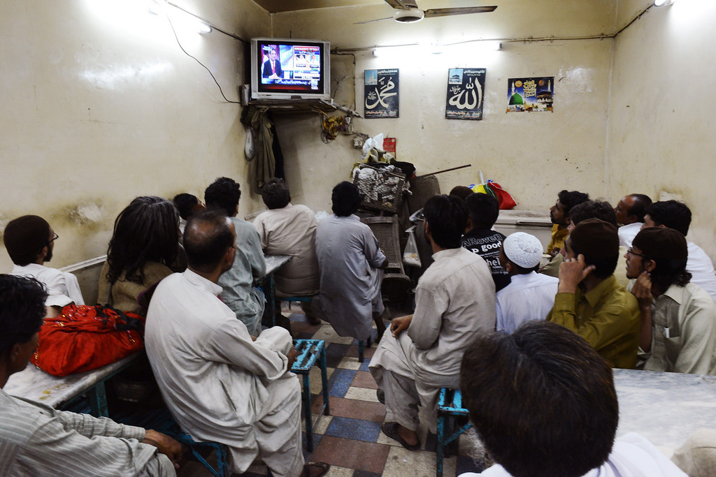 . Pakistani men crowd a small tea hall as they watch live news reports of incoming elections results after the polls closed in Lahore on May 11, 2013.   Counting got underway Saturday in Pakistan\'s landmark elections after millions of people defied deadly Taliban attacks to take part in an historic democratic transition in the nuclear-armed state. ROBERTO SCHMIDT/AFP/Getty Images