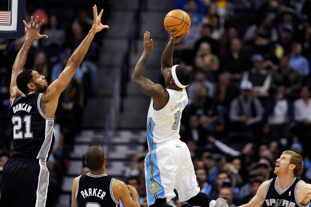 . Ty Lawson #3 of the Denver Nuggets goes up for a floating jump shot against Tim Duncan #21 of the San Antonio Spurs during the fourth quarter of an NBA game at the Pepsi Center on November 5, 2013, in Denver, Colorado. The Nuggets fell to the Spurs 102-94 and are now 0-3.  (Photo by Daniel Petty/The Denver Post)