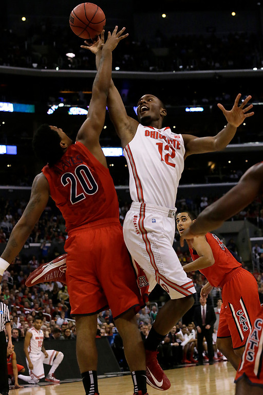 . Ohio State\'s Sam Thompson shoots over Arizona\'s Jordin Mayes, left, in the first half in the NCAA Tournament Sweet 16 game at Staples Center in Los Angeles, California, on Thursday, March 28, 2013. (Robert Gauthier/Los Angeles Times/MCT)