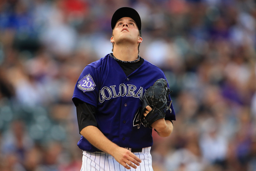 . DENVER, CO - JULY 27:  Starting pitcher Collin McHugh #43 of the Colorado Rockies watches a fly ball hit against him by the Milwaukee Brewers at Coors Field on July 27, 2013 in Denver, Colorado.  (Photo by Doug Pensinger/Getty Images)