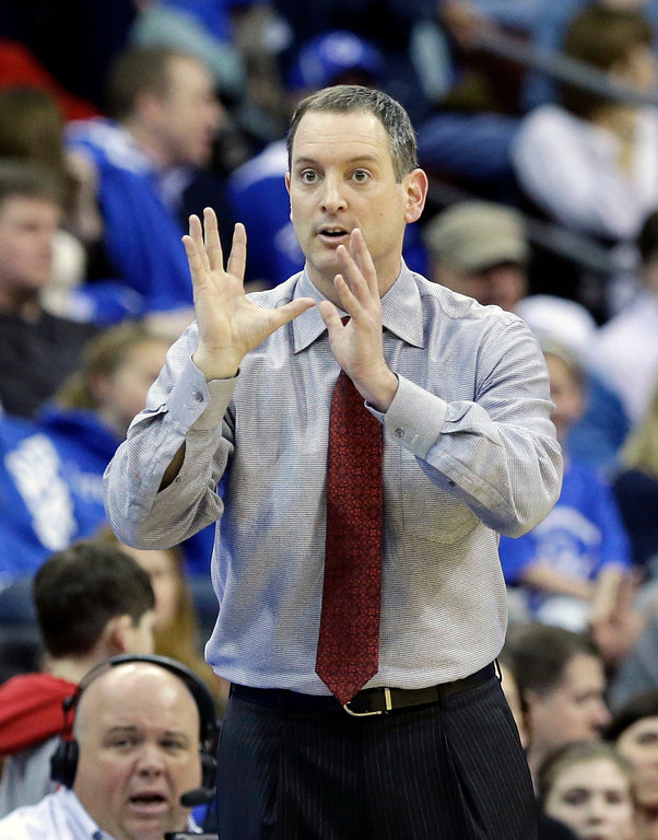 . Rutgers head coach Mike Rice reacts to play during the second half of an NCAA college basketball game against Seton Hall, Friday, March 8, 2013, in Newark, N.J. Rutgers won 56-51. (AP Photo/Mel Evans)