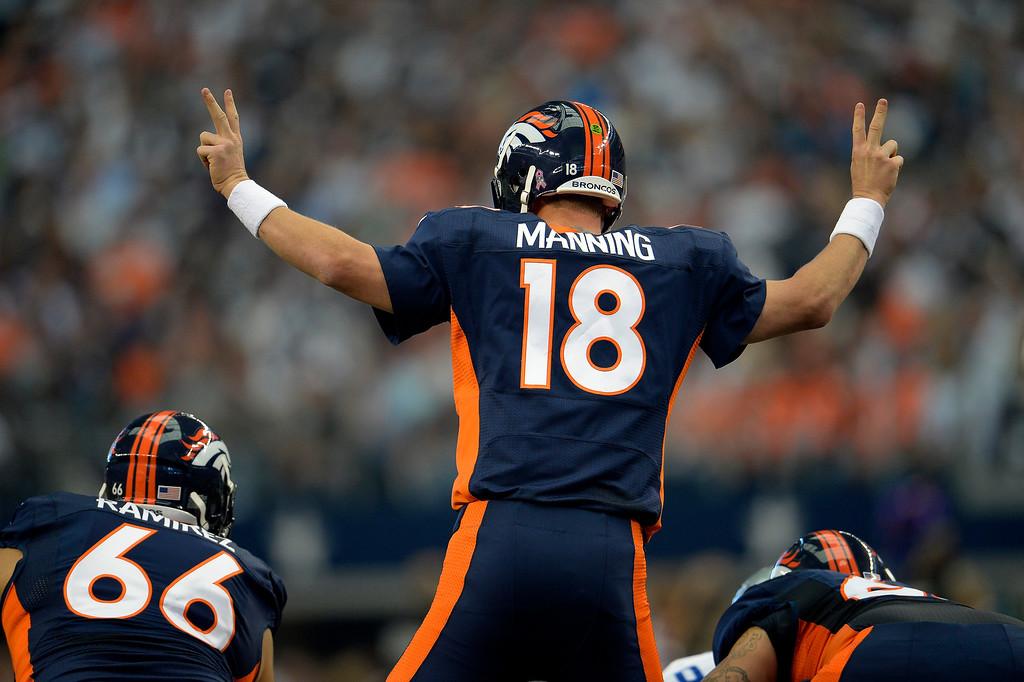 . Quarterback Peyton Manning #18 of the Denver Broncos calls a play against the Dallas Cowboys at AT&T Stadium October 06, 2013 Arlington, Texas. (Photo By Joe Amon/The Denver Post)