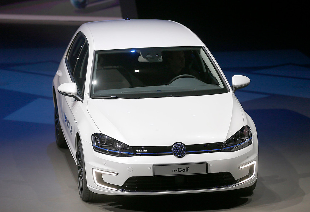 . The new Volkswagen e-Golf displayed during a preview by the Volkswagen Group prior to the 65th Frankfurt Auto Show in Frankfurt, Germany, Monday, Sept. 9, 2013. More than 1,000 exhibitors will show their products to the public from Sept. 12 through Sept. 22, 2013. (AP Photo/Frank Augstein)