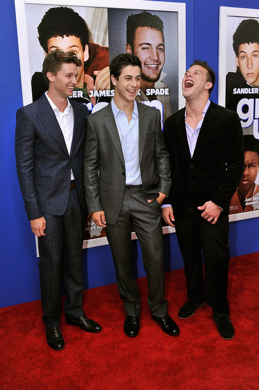 ". Patrick Schwarzenegger, David Henrie, and Jimmy Tatro attend the ""Grown Ups 2\"" New York Premiere at AMC Lincoln Square Theater on July 10, 2013 in New York City.  (Photo by Stephen Lovekin/Getty Images)"