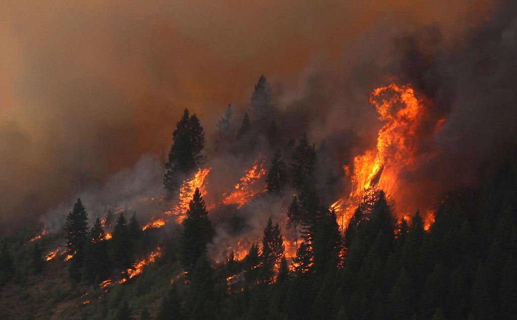 . The 80,300-acre Elk Fire Complex burns across Elmore County, Idaho , Sunday Aug. 11, 2013.  (AP Photo/Times-News,Ashley Smith)