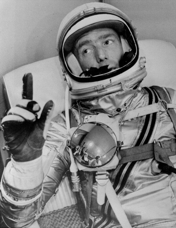 . Astronaut Scott Carpenter gestures with one hand after donning his space suit in Hangar S prior to being shot into orbit at Cape Canaveral, Fla. on May 24, 1962. Carpenter, the second American to orbit the Earth and first person to explore both the heights of space and depths of the ocean, died Thursday, Oct. 10, 2013 after a stroke. He was 88.  (AP photo/NASA, File)