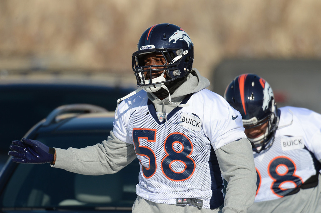 . Von Miller of Denver Broncos (58)  heading to the practice field of Denver Broncos Headquarters at Dove Valley in Englewood, Colorado on Friday,  December 6, 2013. (Photo by Hyoung Chang/The Denver Post)