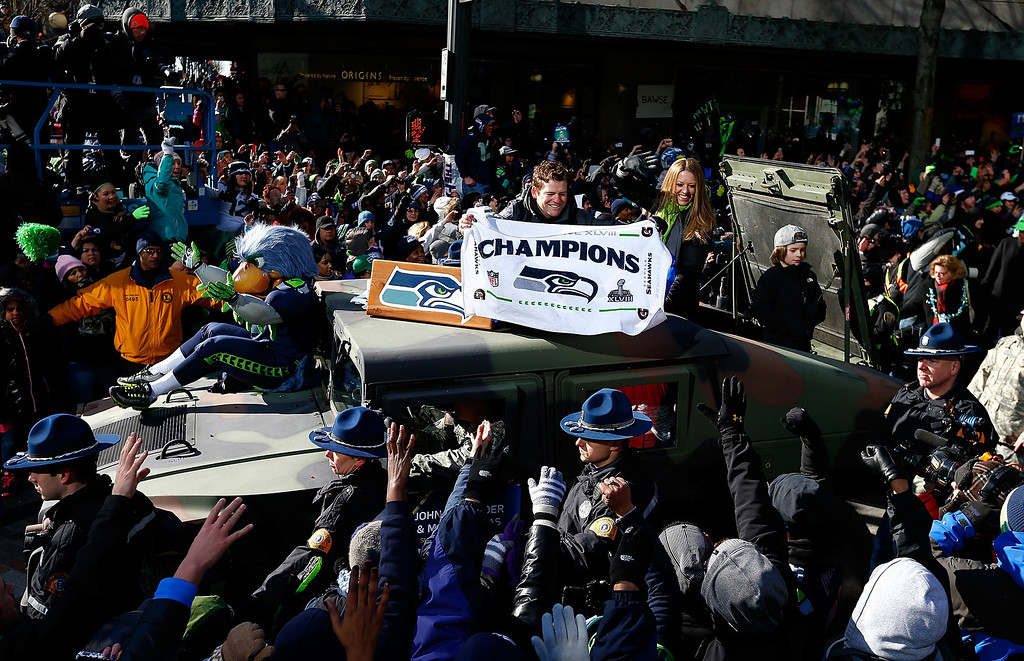 . General Manager John Schneider of the Seattle Seahawks waves to fans during a parade to celebrate their  victory in Super Bowl XLVII on February 5, 2014 in Seattle, Washington.  (Photo by Jonathan Ferrey/Getty Images)