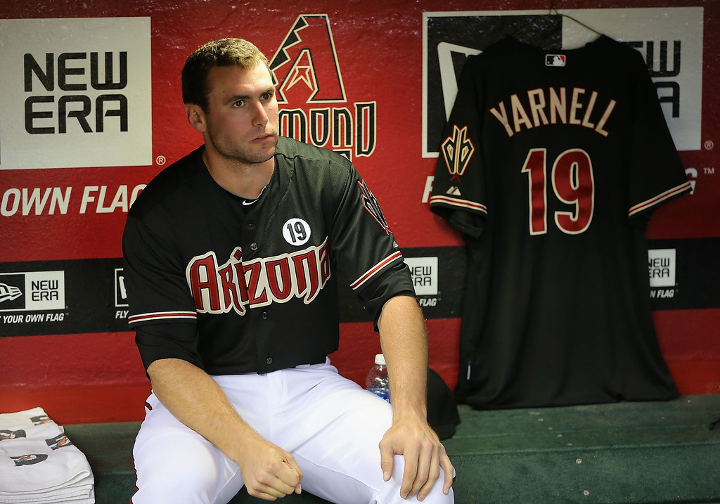 """. PHOENIX, AZ - JULY 05:  Paul Goldschmidt #44  of the Arizona Diamondbacks sits in the dugout before the MLB game against the Colorado Rockies at Chase Field on July 5, 2013 in Phoenix, Arizona. The Arizona Diamondbacks are wearing a \""""19\"""" patch in honor of the 19 Granite Mountain Interagency Hotshot Crew firefighters who died battling a fast-moving wildfire near Yarnell, AZ.  (Photo by Christian Petersen/Getty Images)"""