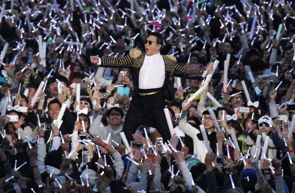 """. SEOUL, SOUTH KOREA - APRIL 13:  Singer PSY performs onstage in his concert titled \""""Happening\"""" at Olympic Stadium on April 13, 2013 in Seoul, South Korea.  (Photo by Chung Sung-Jun/Getty Images)"""