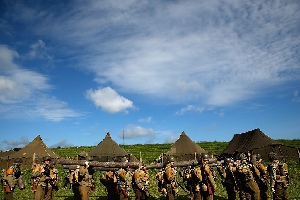 . Military enthusiasts line up to march outside their camp just south of Omaha Beach on the day before the 70th anniversary of D-Day June 5, 2014 in Vierville, France.  (Photo by Win McNamee/Getty Images)