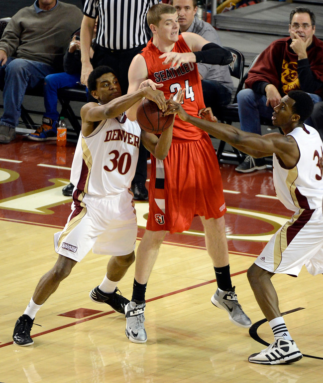 . DENVER, CO. - FEBRUARY 07: Cam Griffin (30) of the Denver Pioneers rips the ball away from Jack Crook (24) of the Seattle Redhawks during the second half February 7, 2013 at Magness Arena. The Denver Pioneers take on the Seattle Redhawks in WAC competition. (Photo By John Leyba/The Denver Post)