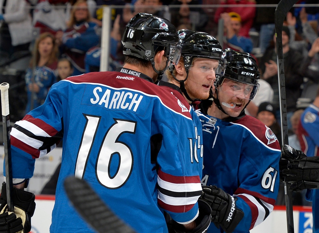 . Colorado Avalanche left wing Gabriel Landeskog, center, from Sweden, is congratulated by teammates Cory Sarich (16) and Andre Benoit (61) after scoring a goal against the Minnesota Wild during the first period of an NHL hockey game Saturday, Nov. 30, 2013, in Denver. (AP Photo/Jack Dempsey)