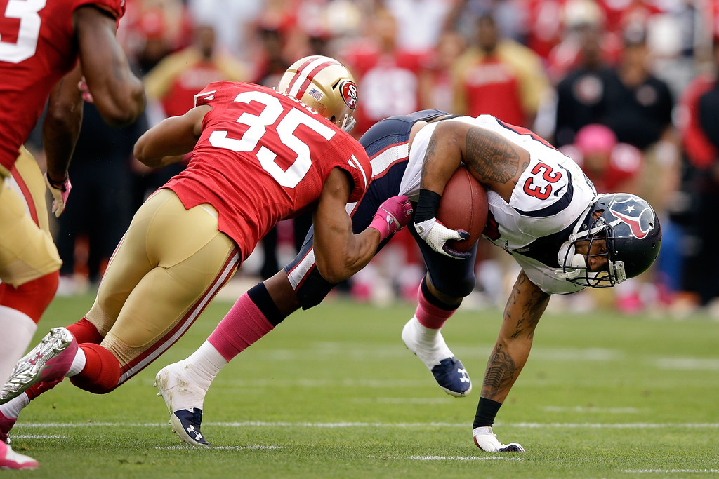 . Eric Reid #35 of the San Francisco 49ers tackles Arian Foster #23 of the Houston Texans during their game at Candlestick Park on October 6, 2013 in San Francisco, California.  (Photo by Ezra Shaw/Getty Images)
