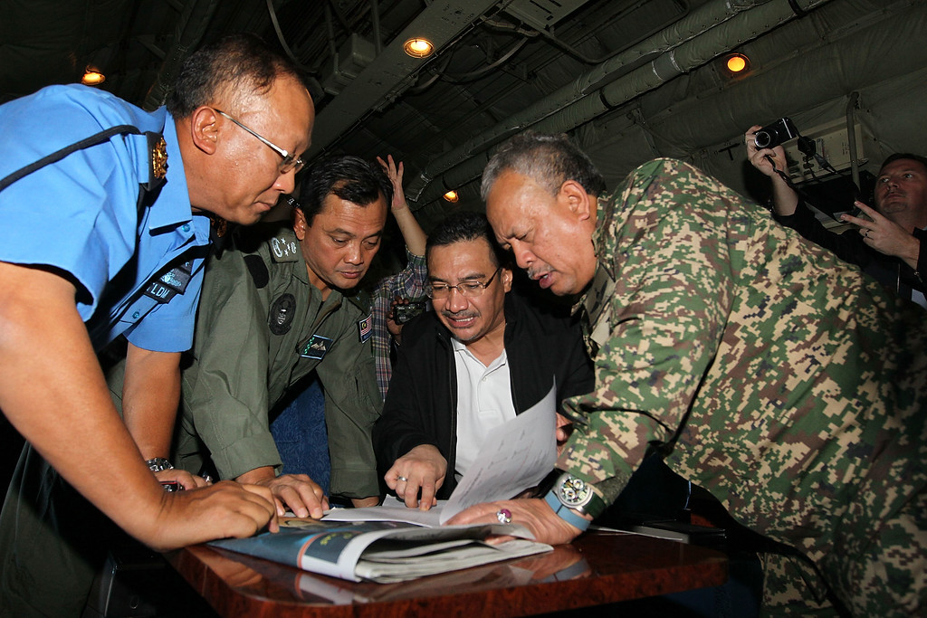 . In this handout provided by the Angkatan Tentera Malaysia, Malaysian Royal Navy (TLDM) commander Tan Sri Abdul Aziz Jaafar (left), Lieutenant General Dato\' Sri Ackbal bin Hj Abdul Samad (2nd left), Malaysian Defence Minister, Minister of Defence & (Acting) Minister of Transport  Dato\' Seri Hishammuddin Hussein (2nd right), and Malaysian Defence Forces chief Tan Sri Zulkifeli Mohd Zin discuss their strategy during a search and rescue mission flight on March 11, 2014 in Kuala Lumpur, Malaysia. (Photo by Angkatan Tentera Malaysia via Getty Images)
