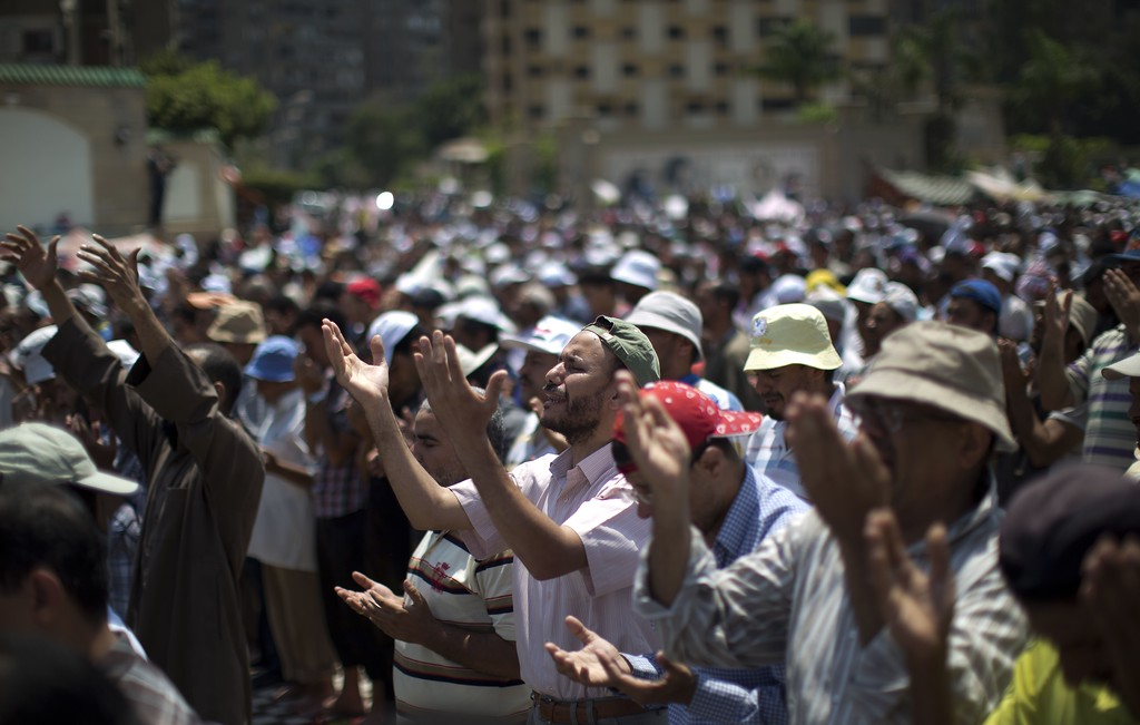 . Egyptian supporters of the Muslim Brotherhood perform the weekly Friday prayers outside Cairo\'s Rabaa al-Adawiya mosque on July 5, 2013. A deadly gunfight erupted in Cairo as thousands of supporters of deposed Egyptian president Mohamed Morsi marched on the Republican Guard headquarters during mass rallies against the Islamist\'s ouster. MAHMUD HAMS/AFP/Getty Images