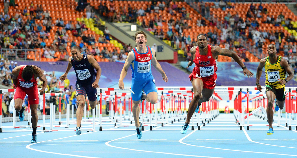 . US\'s David Oliver (2nd-R) wins the men\'s 110 meters hurdles final at the 2013 IAAF World Championships at the Luzhniki stadium in Moscow on August 12, 2013. AFP PHOTO / OLIVIER  MORIN/AFP/Getty Images