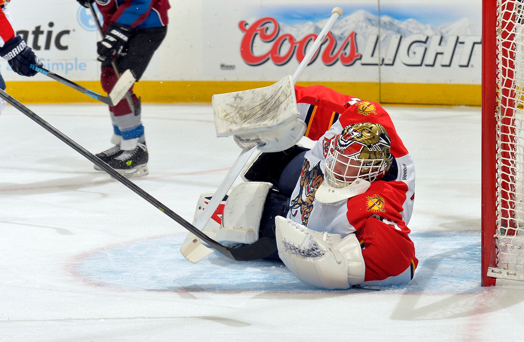 . Florida Panthers goalie Tim Thomas makes a save against the Colorado Avalanche during the first period of an NHL hockey game on Saturday, Nov. 16, 2013, in Denver. (AP Photo/Jack Dempsey)