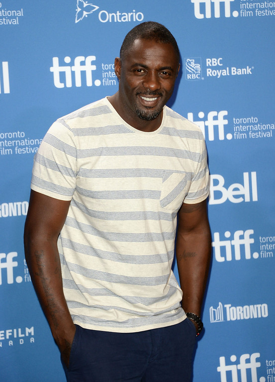 ". Actor Idris Elba attends ""Mandela: Long Walk To Freedom\"" Press Conference during the 2013 Toronto International Film Festival at TIFF Bell Lightbox on September 8, 2013 in Toronto, Canada.  (Photo by Jason Merritt/Getty Images)"