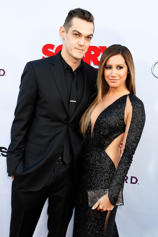 """. Cast member Ashley Tisdale and her boyfriend Christopher French arrive at the premiere of her new film \""""Scary Movie 5\"""" in Hollywood April 11, 2013.  REUTERS/Fred Prouser"""