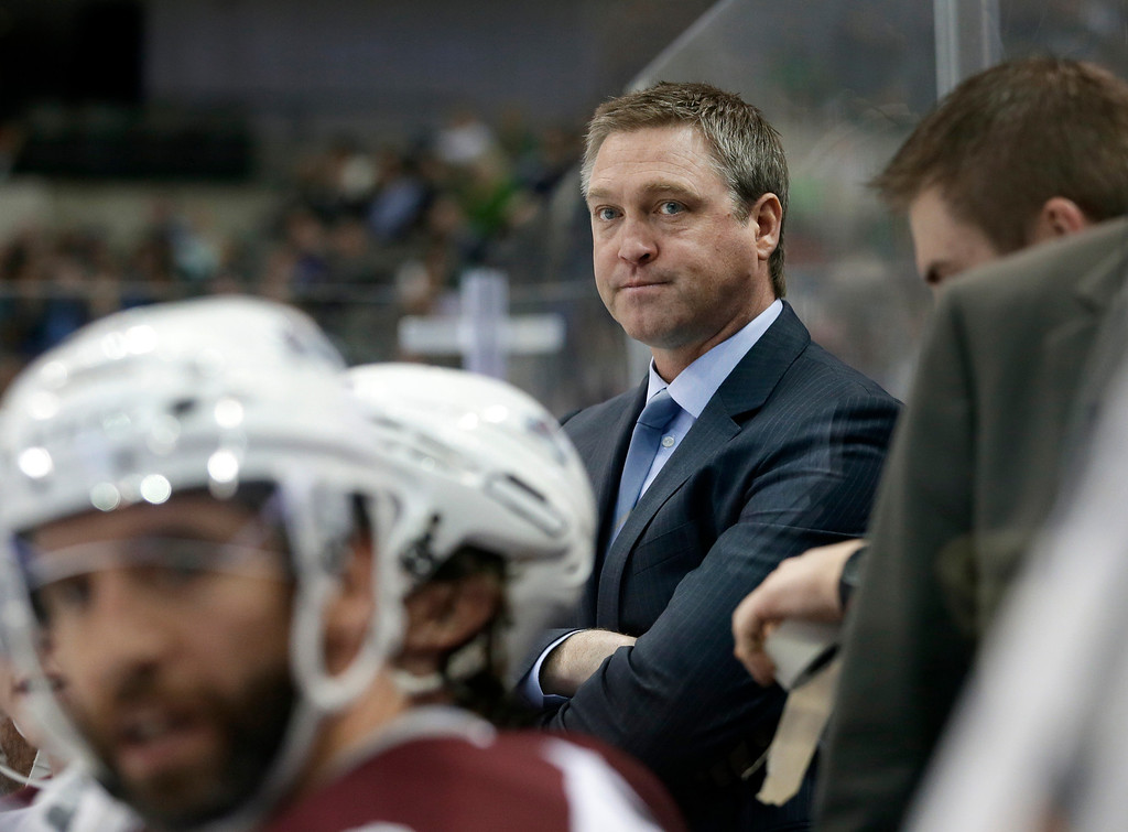 . Colorado Avalanche coach Patrick Roy watches play from the bench in the first period of an NHL hockey game against the Dallas Stars, Friday, Nov. 1, 2013, in Dallas. (AP Photo/Tony Gutierrez)