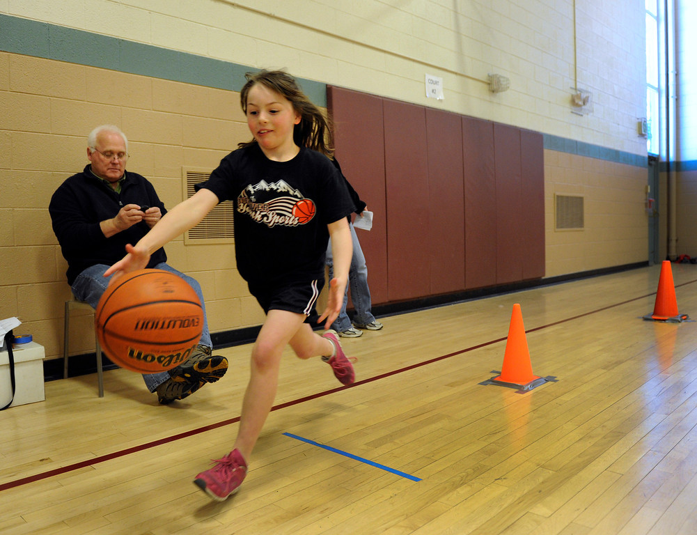 . DENVER, CO. - FEBRUARY 23: Caeli Morin, 8, makes her way through the dribbling skill test. The Tamarac Optimist Club sponsors one of the Tri-Star Basketball Competitions at the Eisenhower Recreation Center in Denver. The competitions are held over a several week period for boys and girls 8-13 years-old. The winners from this competition go on to the regional finals, and those winners will play in the final competition on Mar. 23, 2013 at the Pepsi Center before a Nuggets game. There are still several opportunities for kids to try out. Go to www.tristarbasketball.org for upcoming times and locations. (Photo By Kathryn Scott Osler/The Denver Post)