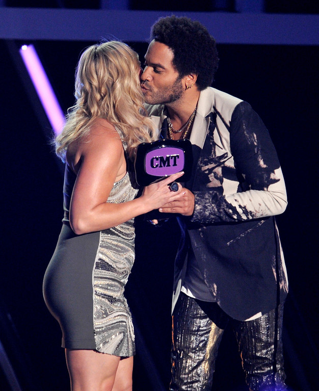 """. Lenny Kravitz, right, presents the award for female video of the year to Miranda Lambert for \""""Mama\'s Broken Heart\"""" at the 2013 CMT Music Awards at Bridgestone Arena on Wednesday, June 5, 2013, in Nashville, Tenn. (Photo by Donn Jones/Invision/AP)"""
