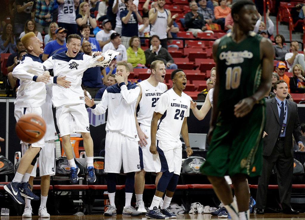 . Utah State\'s bench reacts after Spencer Butterfield sank a 3-point shot to come within one point of Colorado State during the second half of a Mountain West Conference tournament NCAA college basketball game Wednesday, March 12, 2014, in Las Vegas. Utah State defeated Colorado State 73-69. (AP Photo/Isaac Brekken)