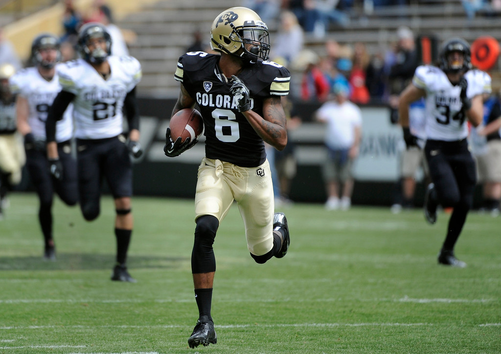 . BOULDER, CO.- APRIL13: Paul Richardson glances over his shoulders as he outpaces his teammates in to the end zone for six points. The University of Colorado football team hosts its spring football game at Folsom Field under the direction of new head coach Mike MacIntyre. (Photo By Kathryn Scott Osler/The Denver Post)