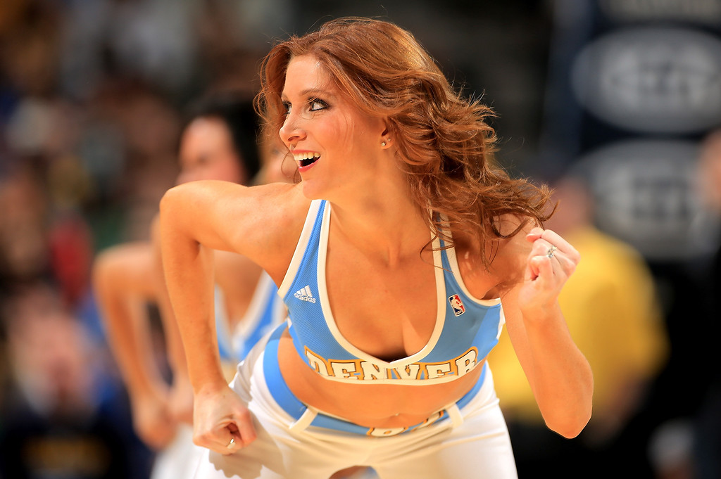 . A member of the Denver Nuggets dance team performs during a break in the action against the Los Angeles Lakers at the Pepsi Center on February 25, 2013 in Denver, Colorado. The Nuggets defeated the Lakers 119-108. NOTE TO USER: User expressly acknowledges and agrees that, by downloading and or using this photograph, User is consenting to the terms and conditions of the Getty Images License Agreement.  (Photo by Doug Pensinger/Getty Images)